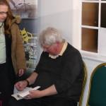 Tim Wander signing books
