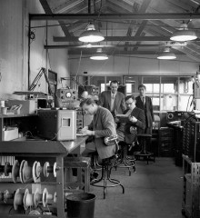 The Aeronautical Comms lab in 1960, shortly before the move to Basildon. Pictured from left to right are Brian Ady, Peter Freeman, Ronald Robertson and Dennis Moore. The office beyond the glass panel was occupied by TT Brown, Coms lab leader, and Wilf Rich, Transmitter lab leader
